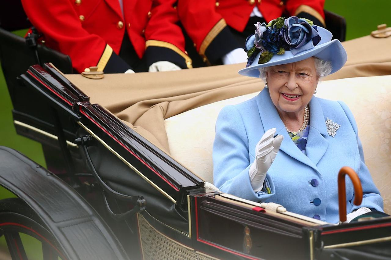 <p>The Queen waves to the attendees as she made her way to the Ascot Racecourse. </p>