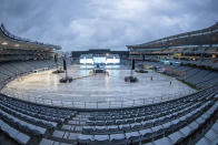A deserted arena and stage before SIX60 undertake a sound check at Eden Park ahead of their concert in Auckland, New Zealand, Friday April 23, 2021. New Zealand band Six60 is being billed as the biggest live act in the world since the coronavirus pandemic struck after New Zealand stamped out the spread of the virus, allowing life to return to normal. On Saturday, the band will play a remarkable finale to their latest tour, performing in front of 50,000 people at the first-ever concert at Auckland's Eden Park. (AP Photo/David Rowland)