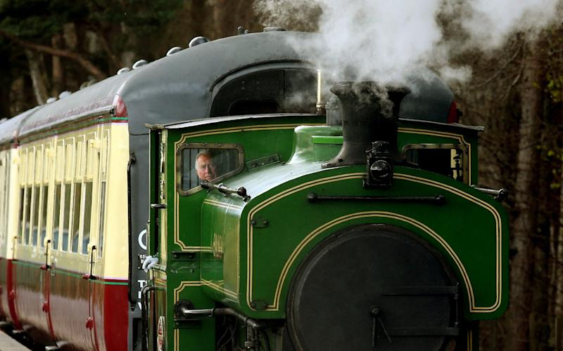"The Prince of Wales, known as the Duke of Rothesay while in Scotland drives the steam train ""Salmon"" during his visit to the Royal Deeside Railway  - Credit: Andrew Milligan/PA"