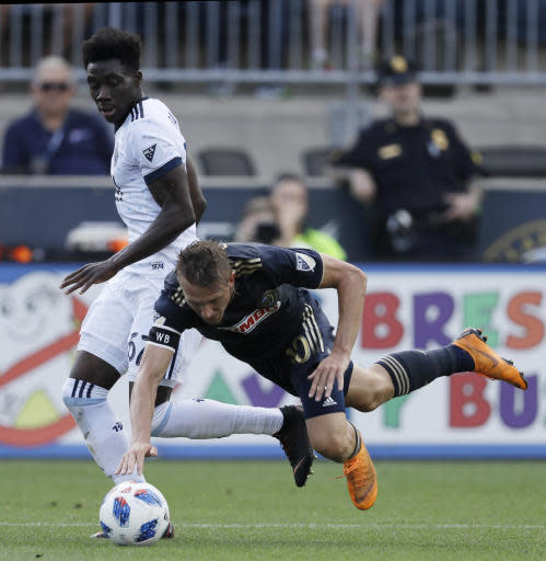 Philadelphia Union's Borek Dockal, right, collides with Vancouver Whitecaps' Alphonso Davies during the first half of an MLS soccer match, Saturday, June 23, 2018, in Chester, Pa. (AP Photo/Matt Slocum)