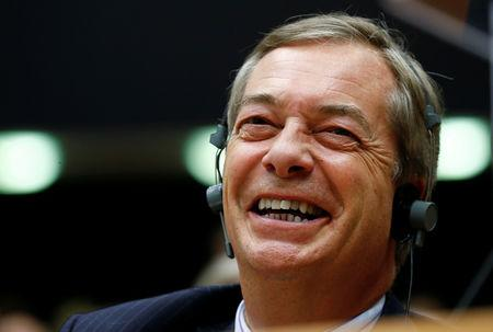 Brexit campaigner Nigel Farage reacts during a plenary session of the EU Parliament in Brussels