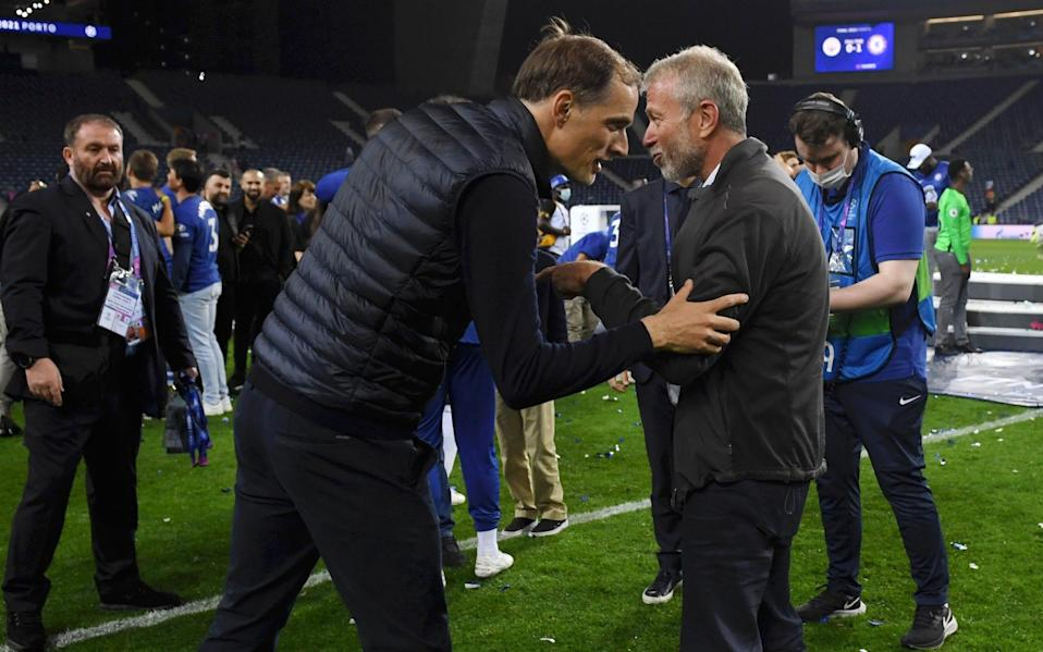 Roman Abramovich (right) joins the Chelsea celebrations on the pitch - GETTY IMAGES