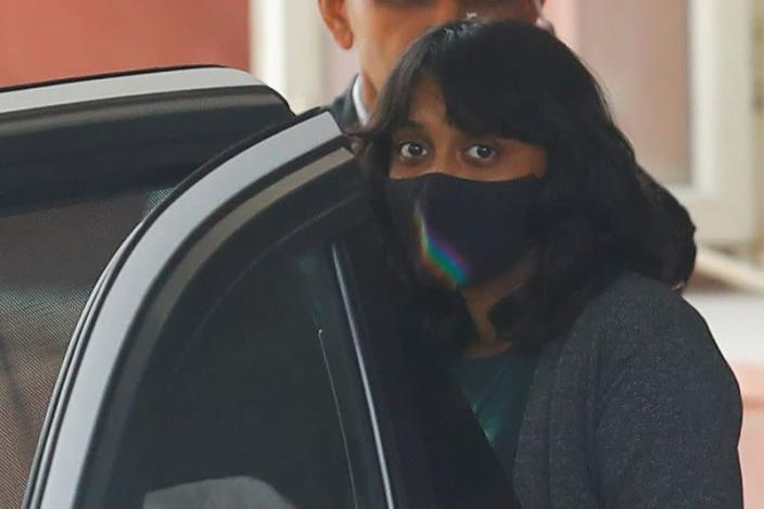 Disha Ravi, a 22-year-old climate activist, leaves after an investigation at National Cyber Forensic Lab, in New Delhi