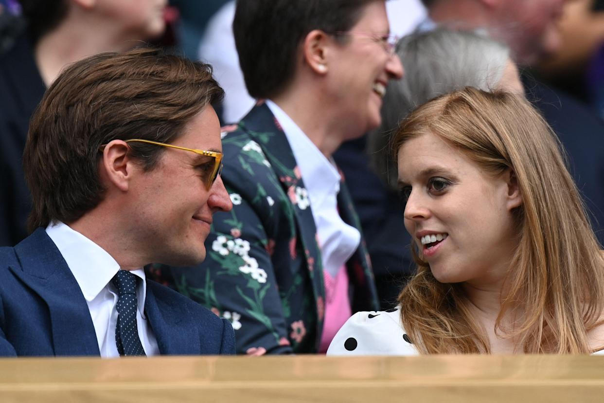 Britain's Princess Beatrice and husband Edoardo Mozzi wait for the start of the women's semi-final matches on the tenth day of the 2021 Wimbledon Championships at The All England Tennis Club in Wimbledon, southwest London, on July 8, 2021. - RESTRICTED TO EDITORIAL USE (Photo by Glyn KIRK / AFP) / RESTRICTED TO EDITORIAL USE (Photo by GLYN KIRK/AFP via Getty Images)