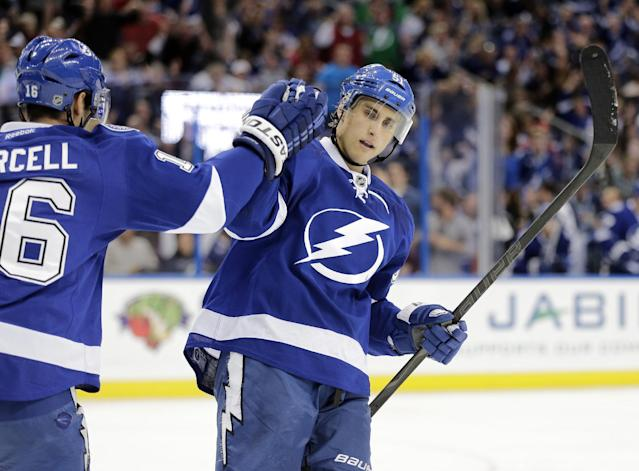 Tampa Bay Lightning center Valtteri Filppula (51), of Finland, celebrates with right wing Teddy Purcell (16) after scoring against the Anaheim Ducks during the second period of an NHL hockey game on Thursday, Nov. 14, 2013, in Tampa, Fla. (AP Photo/Chris O'Meara)