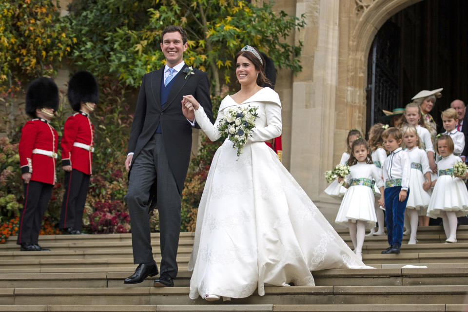 Princess Eugenie of York and Jack Brooksbank leave St George's Chapel in Windsor Castle following their wedding at St. George's Chapel on October 12, 2018 in Windsor, England.
