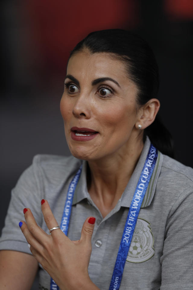"In this photo taken on Wednesday, June 20, 2018, nutritionist Beatriz Boullosa gestures during an interview after a training session of Mexico at the 2018 soccer World Cup in Moscow, Russia. Mexico's mantra for this World Cup is ""No Excuses,"" and that includes no complaining about the food. The team brought two tons of food to Russia, along with everything necessary to make their players favorites, including traditional tacos, cheesy quesadillas and, of course, their hot salsas. (AP Photo/Eduardo Verdugo)"