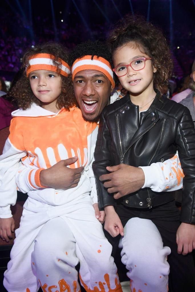 Nick embracing two children