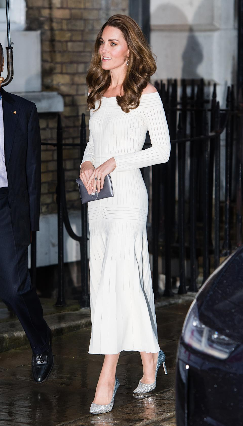 Kate brought back a fan favourite for the first annual gala dinner in recognition of Addiction Awareness Week - her off-the-shoulder Barbara Casasola dress with her glittery Jimmy Choo pumps and a new metallic clutch bag from Wilbur & Gussie. She accessorised with her Kiki McDonough topaz and diamond hoop earrings. [Photo: Getty]