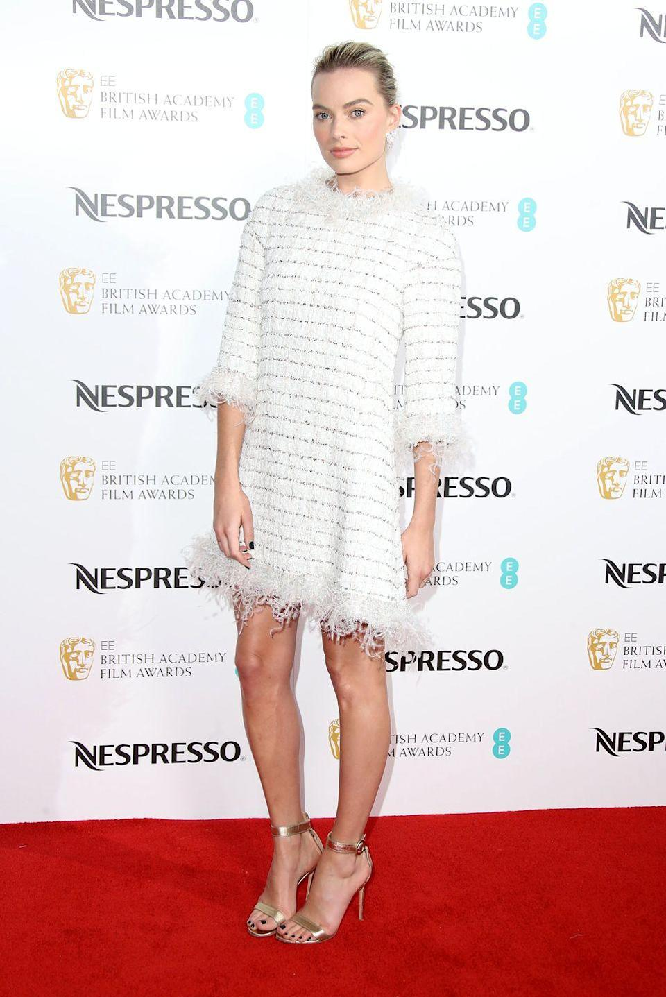 <p>The 27-year-old wore a white fringed Chanel dress to the BAFTA nominees party in London.</p>