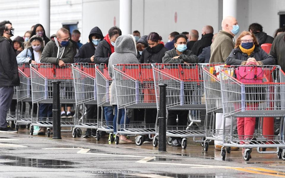 Panic buying is back as customers early today at Costco Manchester wait in the pouring rain - Paul Cousans/Zenpix Ltd
