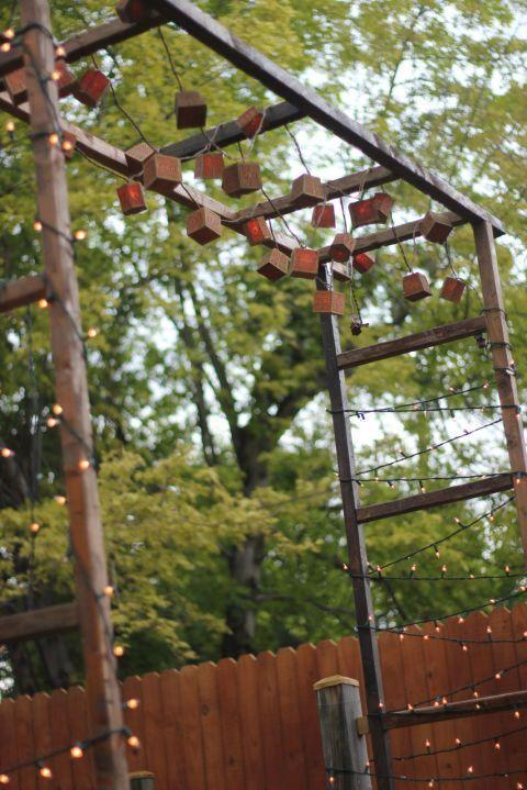 """<p>Use three vintage ladders to construct this sweet, mini pergola, a perfect place to hang lights or use as a backdrop for photos.</p><p><strong>Get the tutorial at <a href=""""http://kojo-designs.com/2011/08/make-it-rustic-garden-gate/"""" rel=""""nofollow noopener"""" target=""""_blank"""" data-ylk=""""slk:Kojo Designs"""" class=""""link rapid-noclick-resp"""">Kojo Designs</a>.</strong> </p><p><strong><a class=""""link rapid-noclick-resp"""" href=""""https://www.amazon.com/Prextex-100-Count-Clear-Christmas-Decorations/dp/B075LQ4WTF/ref=sxin_6_osp104-8d4d435c_cov?tag=syn-yahoo-20&ascsubtag=%5Bartid%7C10050.g.3404%5Bsrc%7Cyahoo-us"""" rel=""""nofollow noopener"""" target=""""_blank"""" data-ylk=""""slk:Shop Christmas lights"""">Shop Christmas lights</a><br></strong></p>"""