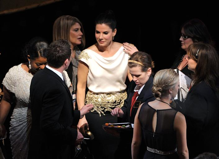 HOLLYWOOD, CA - FEBRUARY 26: Actress Sandra Bullock (C) attends the 84th Annual Academy Awards held at the Hollywood & Highland Center on February 26, 2012 in Hollywood, California. (Photo by Kevin Winter/Getty Images)