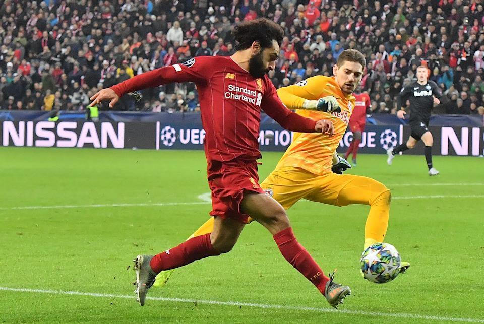 Liverpool's Egyptian midfielder Mohamed Salah scores during the UEFA Champions League Group E football match between RB Salzburg and Liverpool FC on December 10, 2019 in Salzburg, Austria. (Photo by JOE KLAMAR / AFP) (Photo by JOE KLAMAR/AFP via Getty Images)