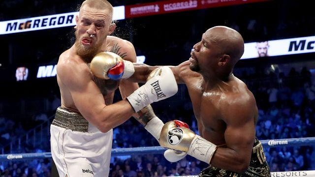 Mayweather lands another blow on McGregor. Image: Getty