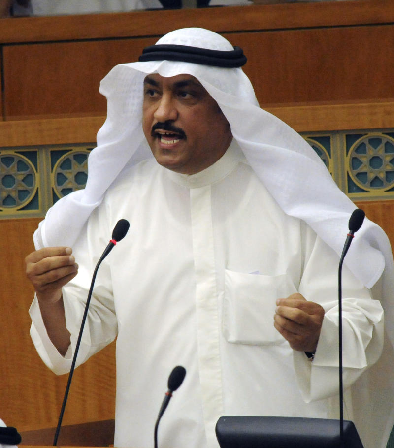 FILE -- In this  Wednesday, July 1, 2009 file photo, Kuwaiti Islamist lawmaker Mussallam al-Barrak speaks  at the National Assembly in Kuwait. Kuwait opposition groups say one of their leaders, former parliament member Mussallam al-Barrack, has been sentenced to five years in prison on charges of insulting the emir during a political rally last year. The sentence against Al-Barrack could rekindle street protests that flared during disputes over parliamentary elections in December. Al-Barrack led a boycott movement to protest changes in voting rules ordered by the emir.  (AP Photo / Gustavo Ferrari, File)