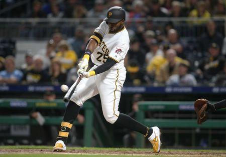 FILE PHOTO: Apr 22, 2019; Pittsburgh, PA, USA; Pittsburgh Pirates right fielder Gregory Polanco (25) hits a double against the Arizona Diamondbacks during the fifth inning at PNC Park. Mandatory Credit: Charles LeClaire-USA TODAY Sports