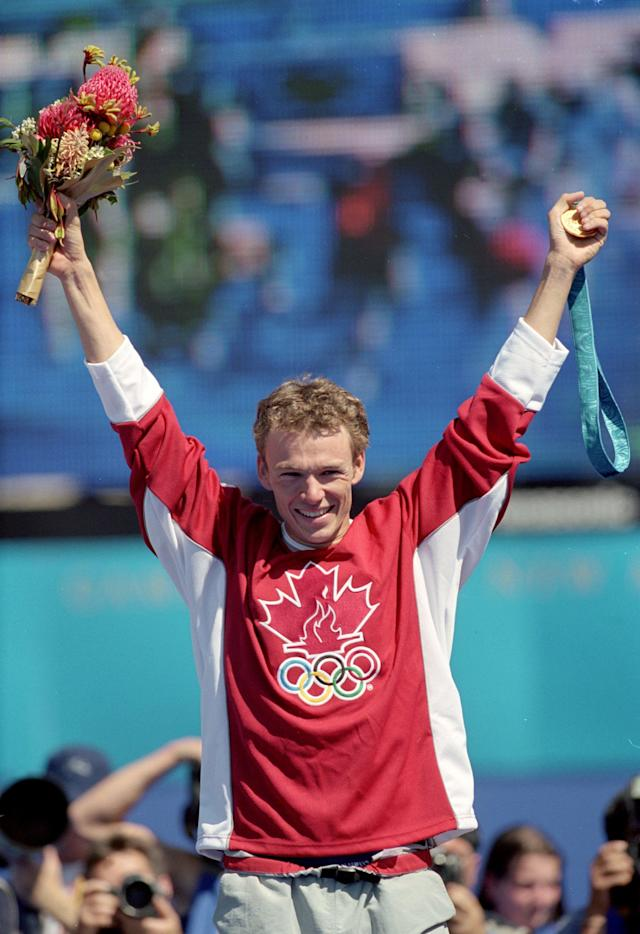17 Sep 2000: Simon Whitfield of Canada celebrates his Gold Medal victory of the Men's Triathlon at the Sydney Opera House in Sydney, Australia.Mandatory Credit: Donald Miralle /Allsport