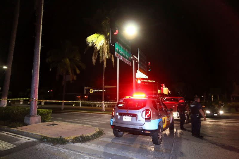 Police officers guard a crime scene where an unidentified assailant shot dead Aristoteles Sandoval, ex-governor of the Mexican state of Jalisco, in Puerto Vallarta, Mexico