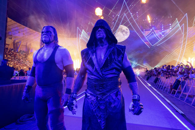 "Kane and the Undertaker are seen during the ""Crown Jewel"" event in Saudi Arabia in November 2018. (Photo courtesy of WWE)"
