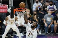 Los Angeles Lakers center Andre Drummond scores against the Phoenix Suns during the first half of Game 1 of their NBA basketball first-round playoff series Sunday, May 23, 2021, in Phoenix. (AP Photo/Ross D. Franklin)