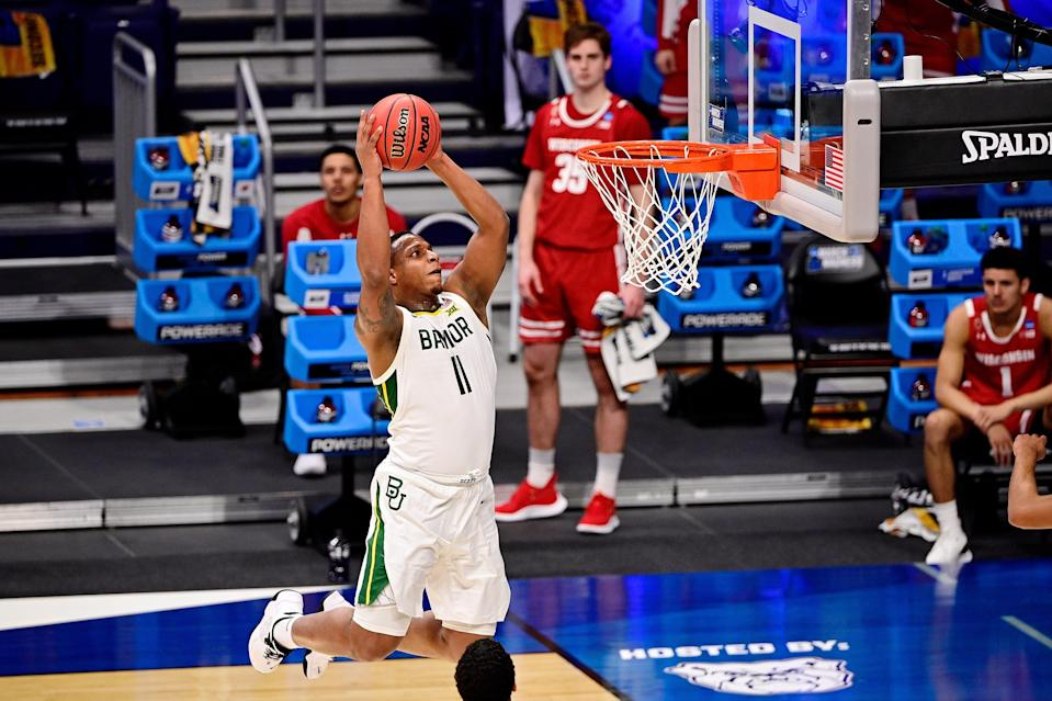 Baylor's Mark Vital (11) dunks against Wisconsin during the first half in the second round of the 2021 NCAA Tournament at Hinkle Fieldhouse.