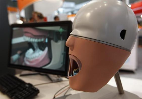 A setup for a digital impression for a denture is pictured at the Hanover industrial fair in Hanover, April 23, 2012.