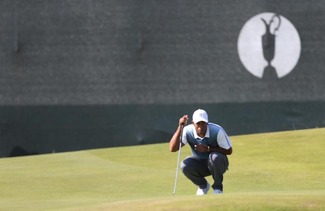 Tiger Woods of the US prepares to putt on the 4th green during the first day of the British Open Golf championship at the Royal Liverpool golf club, Hoylake, England, Thursday July 17, 2014. (AP Photo/Peter Morrison)