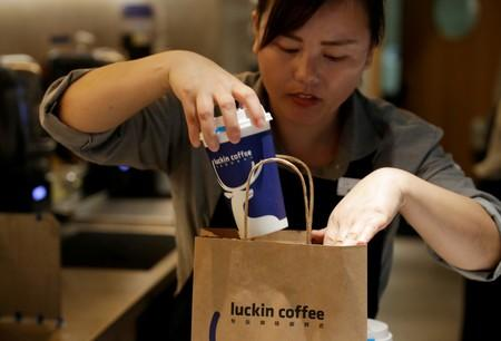 FILE PHOTO: A barista packs a coffee for online sales at a Luckin Coffee store in Beijing, China