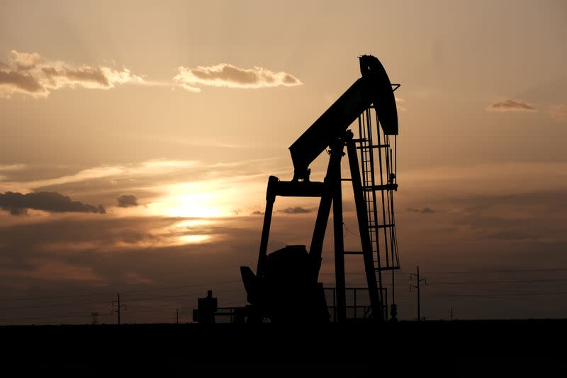 FILE PHOTO: Oil pump jacks work at sunset near Midland
