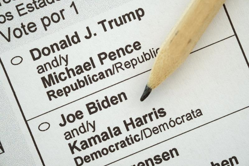 In this photo illustration a pencil lies on a US presidential election mail-in ballot.