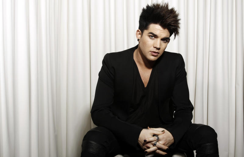 """FILE - In this Jan. 23, 2012 file photo, musician Adam Lambert poses for a portrait in Beverly Hills, Calif. Lambert will host and perform at the """"VH1 Divas""""  event on Dec. 16, in New York. Miley Cyrus, Demi Lovato, Kelly Rowland, Jordin Sparks and Ciara will also hit the stage at the special honoring dance music and its current and classic divas. Tributes to Whitney Houston and Donna Summer are also planned. (AP Photo/Matt Sayles, file)"""