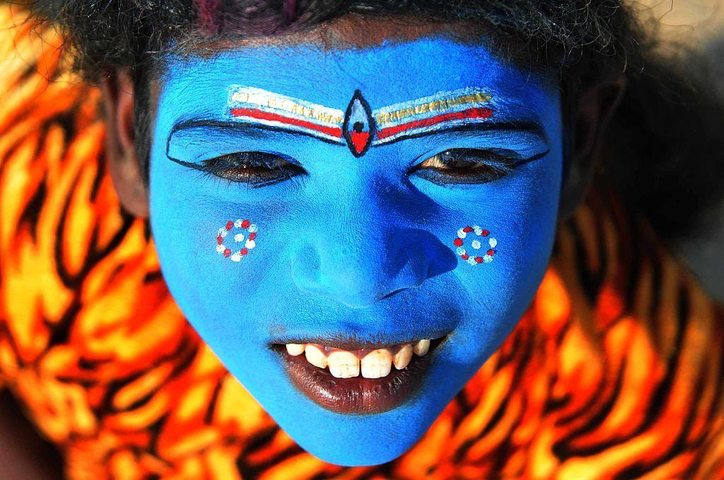<p>A child dressed as the Hindu god Shiva peers into the camera at Sangam, the confluence of River Ganga, Yamuna and Mythological Saraswati. (Prabhat Kumar Verma/Pacific Press/LightRocket via Getty Images) </p>