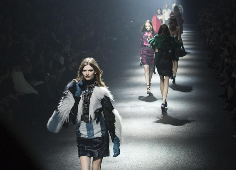 Models wear creations by Israeli fashion designer Alber Elbaz and Dutch fashion designer Lucas Ossendrijver for the fashion house Lanvin collection for her the Fall-Winter, ready-to-wear 2013 fashion collection, during Paris Fashion week, Friday, March 2, 2012. (AP Photo/Jacques Brinon)