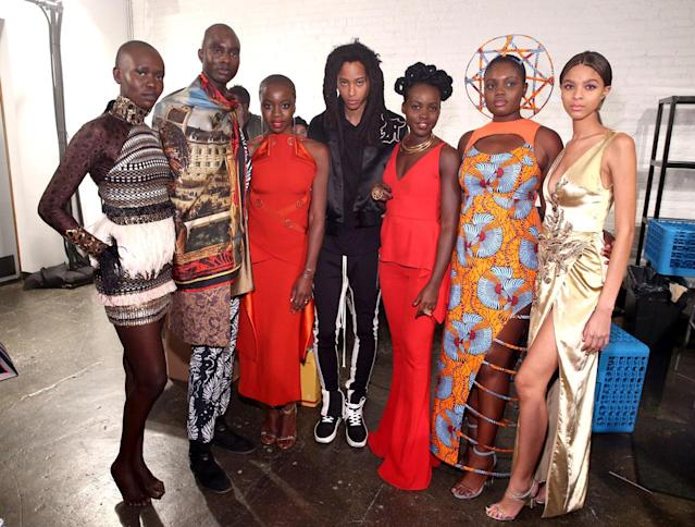 <p>Lupita Nyong'o poses with the models from the Black Panther Welcome to Wakanda NYFW fashion presentation. (Photo: Courtesy of Marvel Studios Black Panther/Getty) </p>