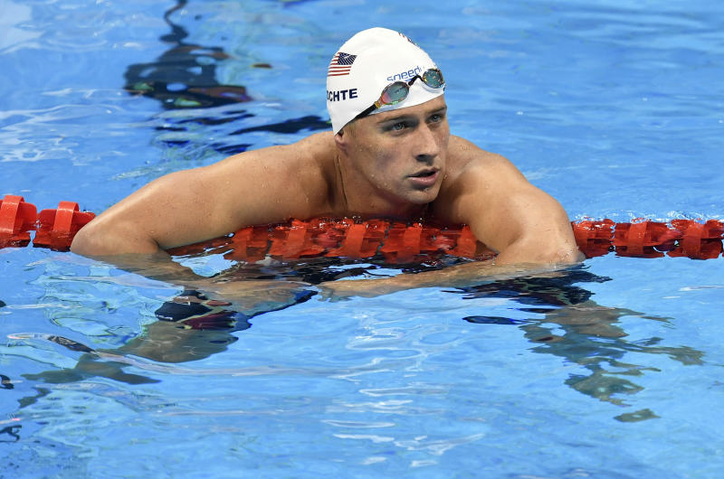 """FILE - In this Aug. 9, 2016, file photo, United States' Ryan Lochte checks his time after a men' 4x200-meter freestyle relay heat during the swimming competitions at the 2016 Summer Olympics in Rio de Janeiro, Brazil. Lochte was named Tuesday, Aug. 30, as one of the contestants on the upcoming edition of ABC's """"Dancing with the Stars."""" (AP Photo/Martin Meissner, File)"""