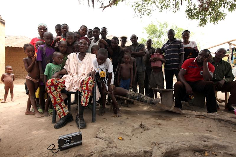 Village head Ogboche James Elamije and members of community listens to a radio broadcast about unrest in the community following attacks by Fulani herdsmen at Agatu community in Benue State (AFP Photo/Emmannuel Arewa)