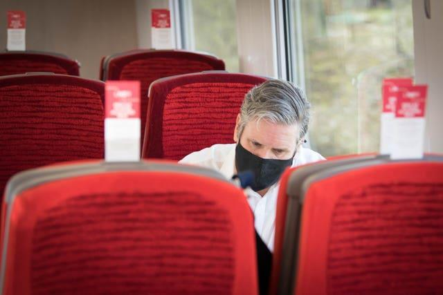 Labour Party leader Sir Keir Starmer takes the train to Hartlepool (Stefan Rousseau/PA)