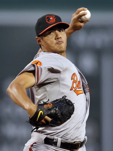 Baltimore Orioles starting pitcher Wei-Yin Chen delivers to the Boston Red Sox in the first inning of a baseball game at Fenway Park in Boston, Tuesday, Aug. 27, 2013. (AP Photo/Elise Amendola)