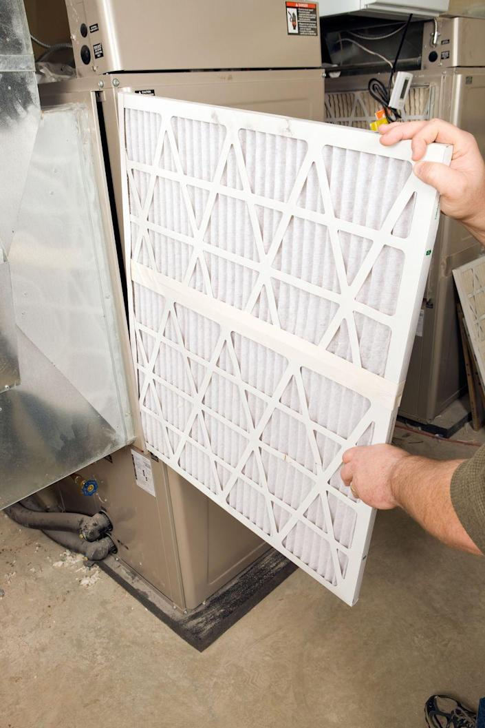 """<p>""""While replacing the filter, spend a minute or so looking around the furnace to make sure you don't hear any strange noises, see any leaks, or any lights flashing that may indicate a problem,"""" says Bill Samuel, a general contractor and residential real estate developer with <a href=""""http://www.blueladderdevelopment.com/"""" rel=""""nofollow noopener"""" target=""""_blank"""" data-ylk=""""slk:Blue Ladder Development"""" class=""""link rapid-noclick-resp"""">Blue Ladder Development</a>. This will help ensure that your unit is operating at top efficiency. If you have humidifier pad installed in your furnace, you'll want to replace a fresh pad and adjust the knob from off to about 40-50 percent humidity.</p>"""