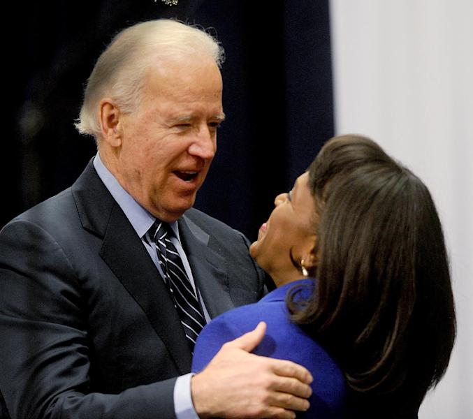 U.S. Vice President Joe Biden hugs U.S. Rep. Terri Sewell Sunday, March 3, 2013, during the Martin and Coretta King Unity Brunch at Wallace Community College in Selma, Ala. The Selma Bridge Crossing Jubilee commemorates the anniversary of the voting rights march of 1965. (AP Photo/The Birmingham News, Julie Bennett)