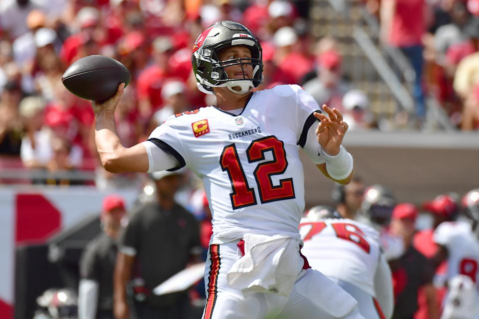 TAMPA, FLORIDA - OCTOBER 10: Tom Brady #12 of the Tampa Bay Buccaneers throws a pass during the second quarter against the Miami Dolphins at Raymond James Stadium on October 10, 2021 in Tampa, Florida. (Photo by Julio Aguilar/Getty Images)