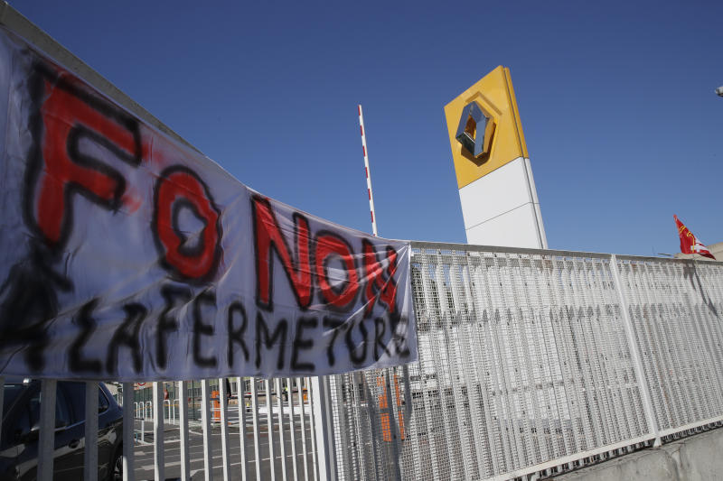 """FILE - In this May 29, 2020 file photo, a union banner reading """"No to the closure"""" hangs on the fence of the Renault plant in Choisy-le-Roi, outside Paris. Struggling French carmaker Renault announced 15,000 job cuts worldwide as part of a 2 billion euros cost-cutting plan over three years. That's the harsh truth facing workers laid off around the world, from software companies in Israel to restaurants in Thailand and car factories in France, whose livelihoods fell victim to a virus-driven recession that's accelerating decline in struggling industries and upheaval across the global workforce. (AP Photo/Christophe Ena, File)"""
