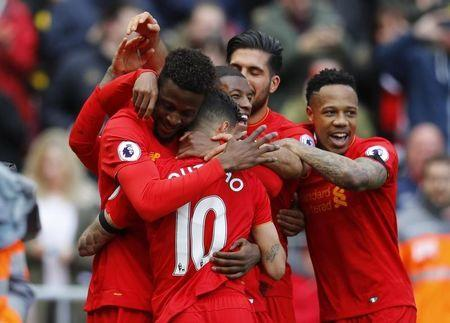 Britain Soccer Football - Liverpool v Everton - Premier League - Anfield - 1/4/17 Liverpool's Divock Origi celebrates scoring their third goal with team mates Reuters / Phil Noble Livepic