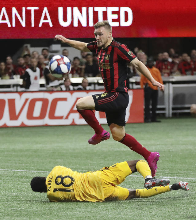 Atlanta United's Julian Gressel scores a goal against Philadelphia Union goalkeeper Andre Blake during the first half of an MLS soccer Eastern Conference semifinal Thursday, Oct. 24, 2019, in Atlanta. (Curtis Compton/Atlanta Journal-Constitution via AP)