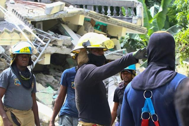 Rescue workers search through destroyed buildings in Les Cayes in southwestern Haiti, which was hit hard by a 7.2-magnitude earthquake on Saturday