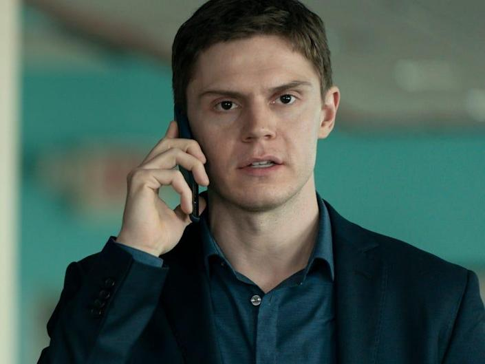 """Evan Peters holding a phone on """"Mare of Easttown."""""""