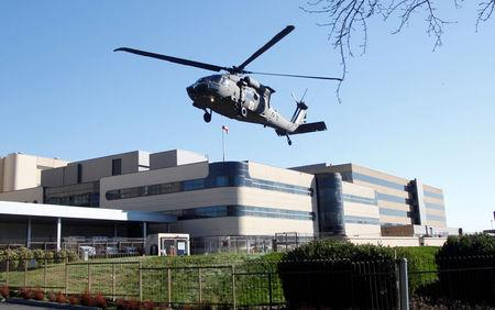 An Oregon Army National Guard Black Hawk helicopter lifts off after a rescue from Mount Hood, at Legacy Emanuel Medical Center in Portland, Oregon, U.S., February 13, 2018. REUTERS/Steve Dipaola