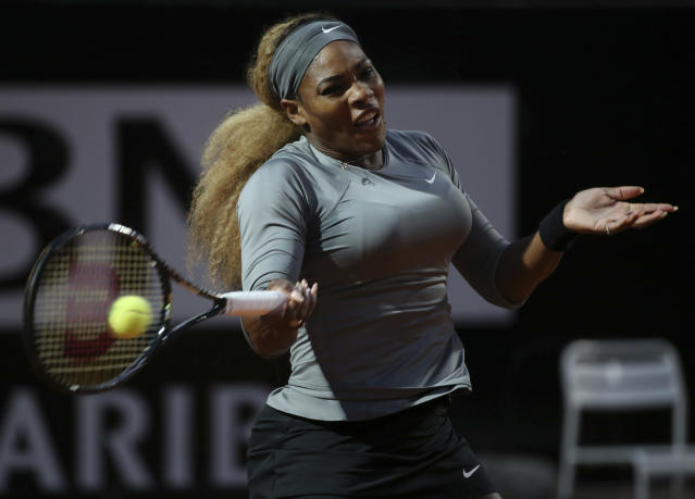 Serena Williams returns the ball to China's Shuai Zhang during their match at the Italian open tennis tournament in Rome, Friday, May 16, 2014. (AP Photo/Gregorio Borgia)