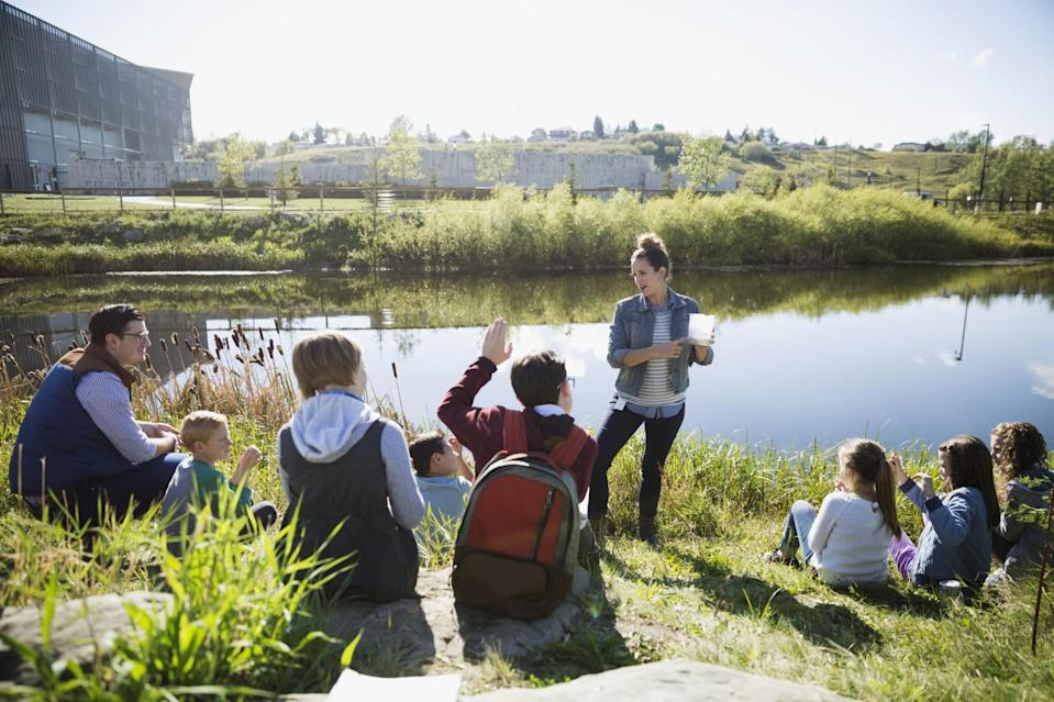 """<p>While we're all being more 'mindful' about the way we bring up our children, we're likely to see this same, more organic, way of thinking reflected in our childcare provision. """"Forest Schools are springing up everywhere, even on a 'pop-up' basis in mainstream education,"""" explains Jo Wiltshire, parenting expert for <a rel=""""nofollow noopener"""" href=""""http://www.childcare.co.uk"""" target=""""_blank"""" data-ylk=""""slk:childcare.co.uk"""" class=""""link rapid-noclick-resp"""">childcare.co.uk</a> """"Children go outside, work as a team, learn about nature and get hands-on. An increasing amount of nurseries and primary schools are offering this approach, and we may see childminders also focusing on the outdoors too, as an 'added value' provision for families who value it."""" According to Jo nature-centred schools are very common in Scandinavian countries and across Europe, and this is an area the UK is just starting to catch on to. """"It is a child-led approach which encourages independence and creative thinking, and appeals to a range of personalities and learning styles. Time to get the wellies on and get outside!"""" [Photo: Getty] </p>"""